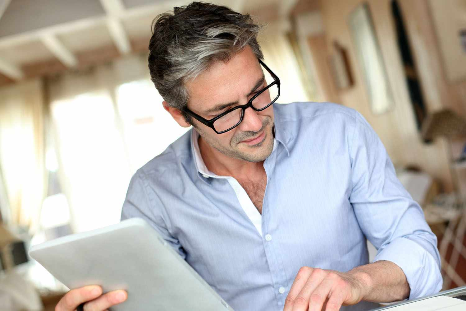 man reading a financial plan